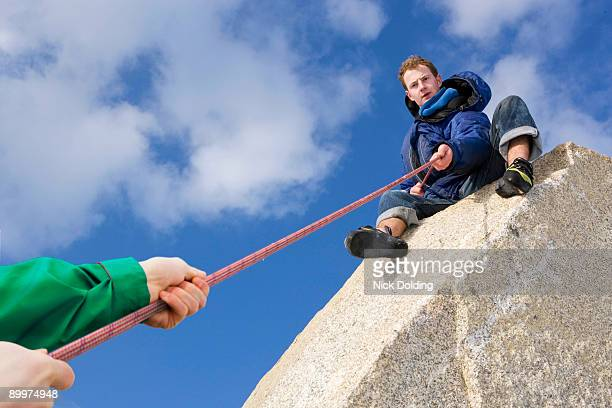 climber belaying fellow climber - stratford london stock pictures, royalty-free photos & images