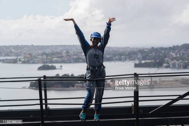 A climber celebrates reaching the Harbour Bridge on March 03 2019 in Sydney Australia The Clean Up Sydney Harbour event was founded by the late Ian...