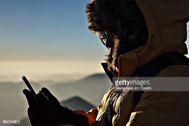 climber communicates via walkie talkie - hairy asian stock pictures, royalty-free photos & images