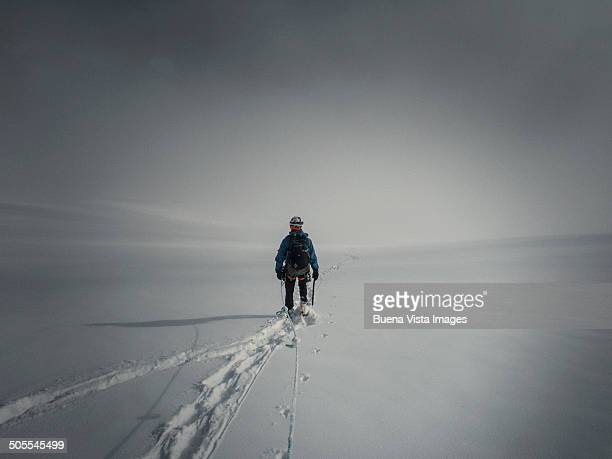 climber descending a glacier in the fog - helmet stock pictures, royalty-free photos & images