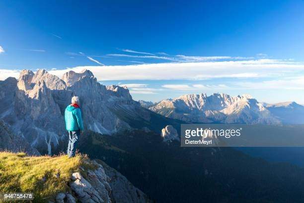 climber enjoys the view at catinaccio, latemar mountain group, south tirol - dolomites stock pictures, royalty-free photos & images