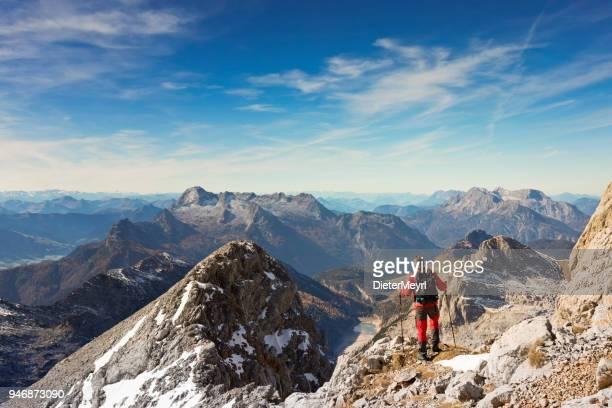 climber enjoys the view in nationalpark berchtesgaden - berchtesgadener land stock photos and pictures