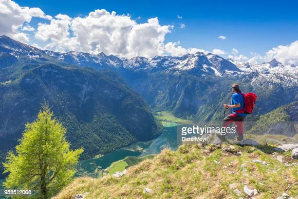 climber enjoys the view in nationalpark berchtesgaden to lake königssee - berchtesgaden national park stock photos and pictures