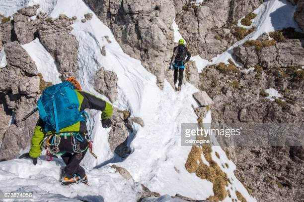 Climber equipped during ascent on top of mountain