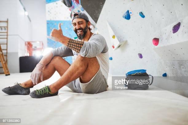 climber expert looking at camera during climbing activities. - chalk bag stock pictures, royalty-free photos & images