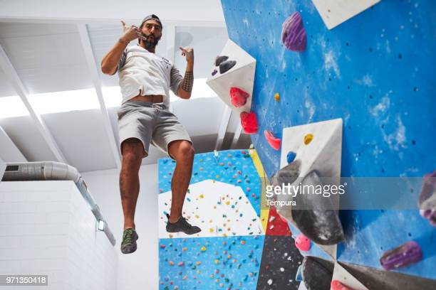 Climber expert looking at camera during climbing activities.