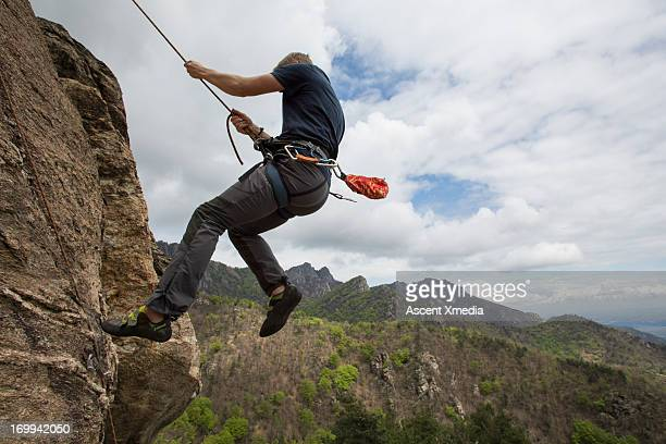 Climber falls from route, swings in mid-air