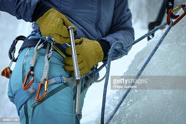 A climber handles an ice screw on an icefall in the Pitztal valley on January 11 2017 near Graslehn Austria Winter weather arrived in Germany and...