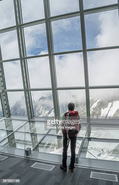 Climber in a futuristic cable car station