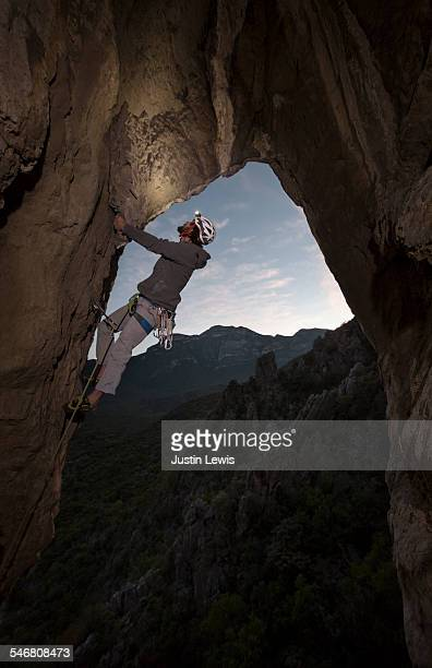 Climber in Challenging Pose