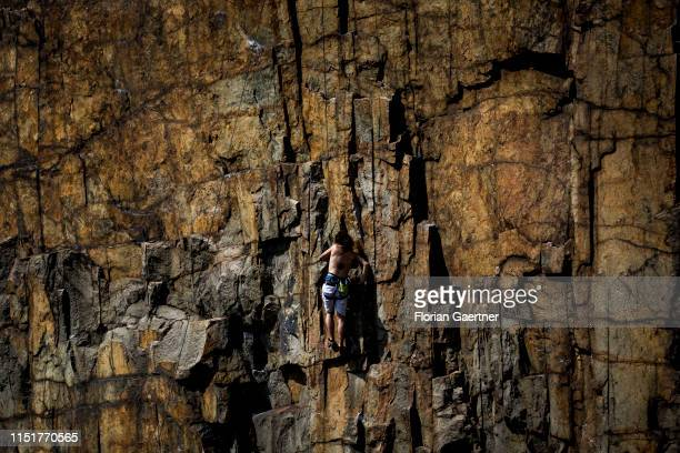 A climber is pictured in a granite quarry on June 23 2019 in Koenigshain Germany