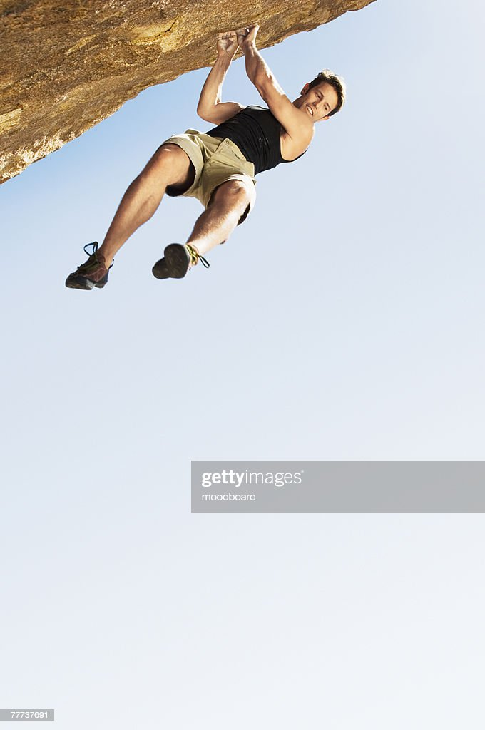 Climber Jumping off Cliff : Stock Photo
