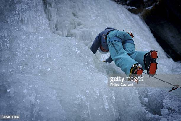 A climber moves up an icefall in the Pitztal valley on January 11 2017 near Graslehn Austria Winter weather arrived in Germany and Austria last week...