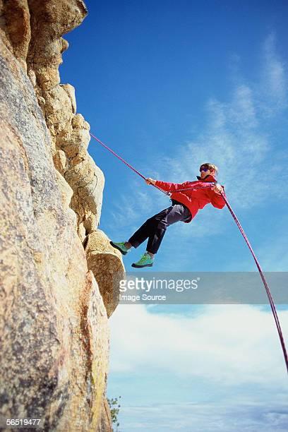 A climber near the top of a rock