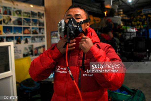 Climber of the winter expedition Mount K2, which is the second highest mountain in the world, tests a oxygen mask before leaving for Pakistan, in...
