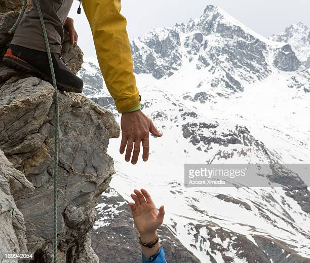 Climber offers teammate a helping hand, mtns