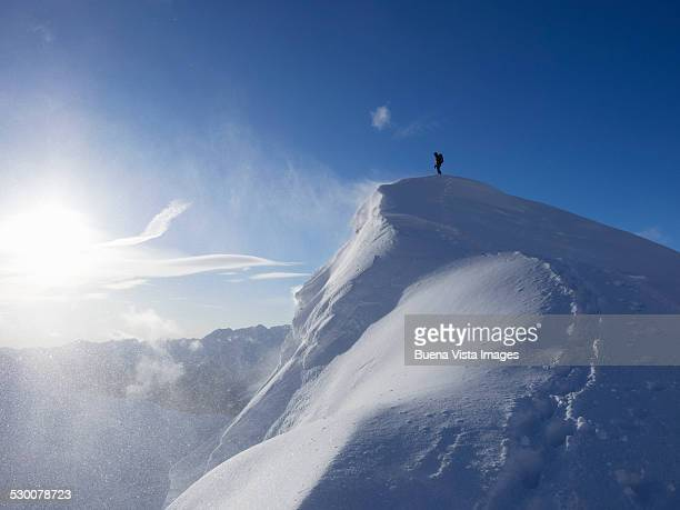 Climber on a mountain top in winter
