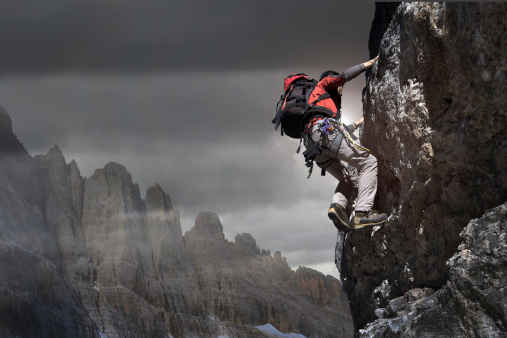Climber on a rocky wall. - gettyimageskorea