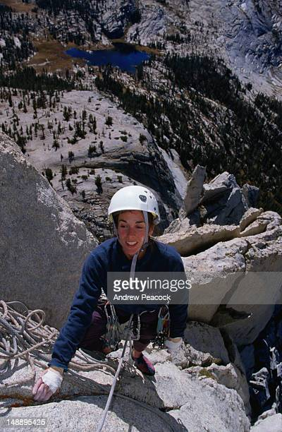climber on an ascent of eichorn pinnacle, cathedral peak. - pinnacle peak stock-fotos und bilder