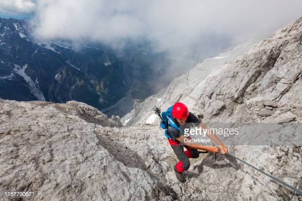 climber on belay at watzmann - alps - baviera foto e immagini stock