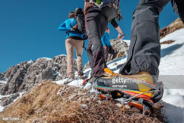 Climber on crampon equipped path in the high mountains