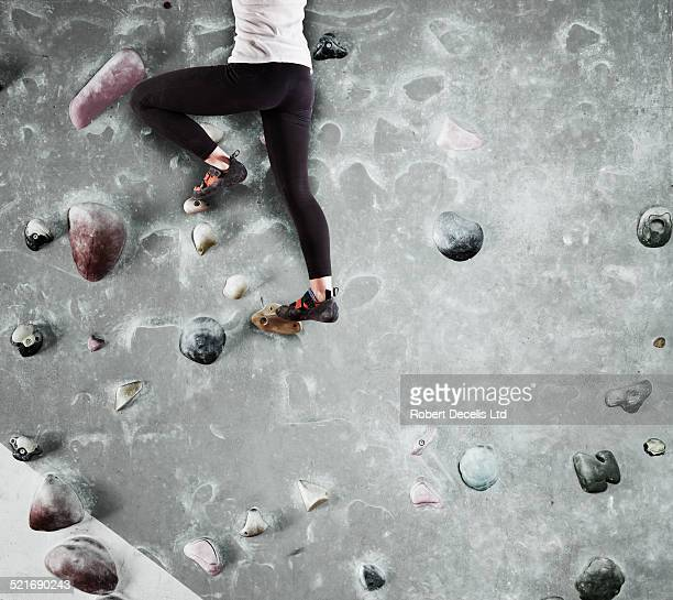 climber on indoor wall climbing out of shot - low section stock pictures, royalty-free photos & images