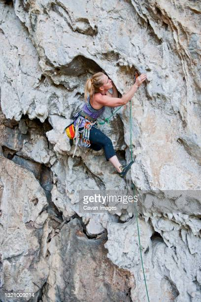 climber on limestone wall at crazy horse buttress in northern thailand - bedrock stock pictures, royalty-free photos & images