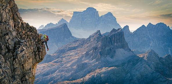 Climber on rocky wall, Dolomites, Cortina d'Ampezzo, Veneto, Italy - gettyimageskorea