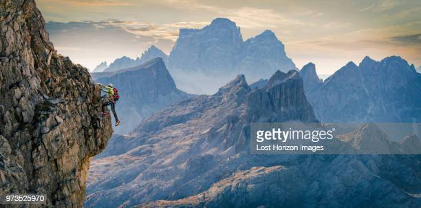 climber on rocky wall, dolomites, cortina d'ampezzo, veneto, italy - climbing stock pictures, royalty-free photos & images