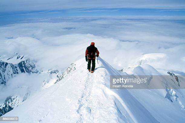 climber on steep summit of mountain in snow. - monte bianco foto e immagini stock