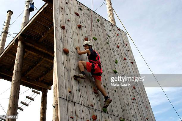 Climber on the wood climbing wall in Amusement Park