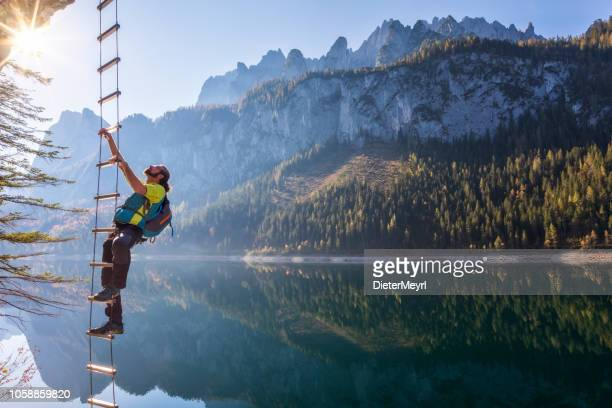 climber on via ferrata at gosausee with dachstein view - european alps - upper austria stock pictures, royalty-free photos & images
