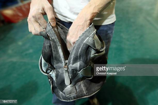Climber picks up chalk from his bag during the climping and bouldering at Wupperwaende Hall on March 27, 2013 in Wuppertal, Germany.