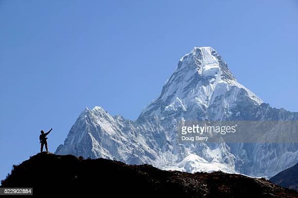 Climber Pointing to Mountain Peak