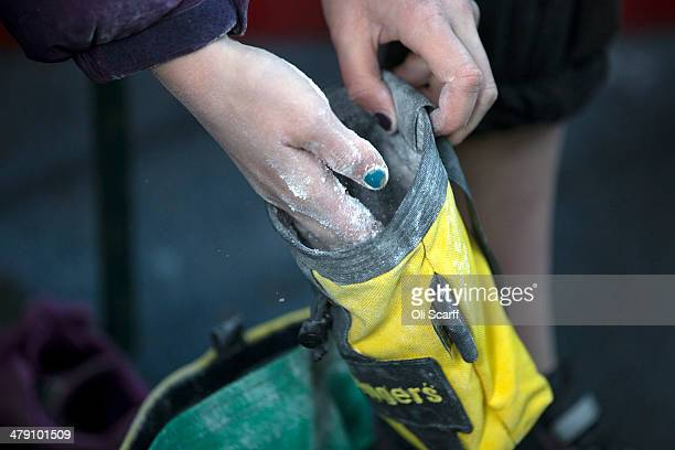 Climber prepares her chalk bag before taking part in the CWIF international bouldering competition on March 16, 2014 in Sheffield, England. The...