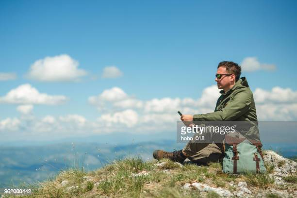 Climber resting on the top of mountain