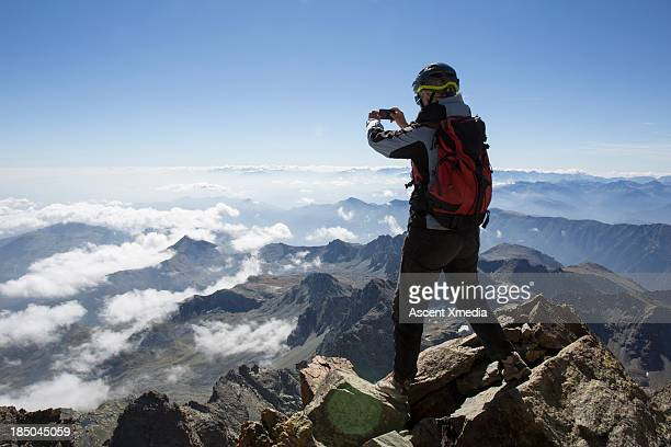 Climber takes smart phone pic from mountain summit