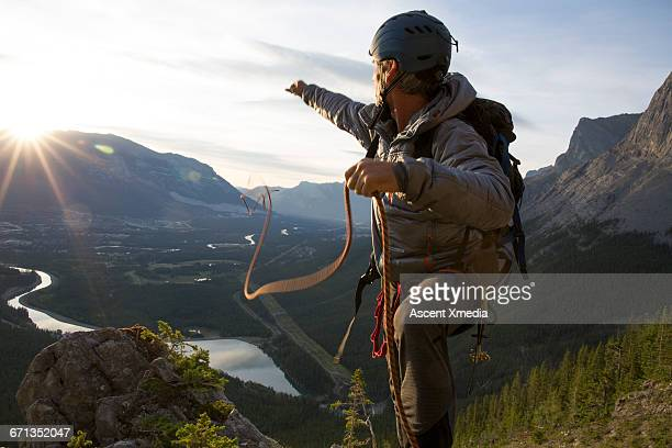 Climber tosses rope out for rappel (abseil)