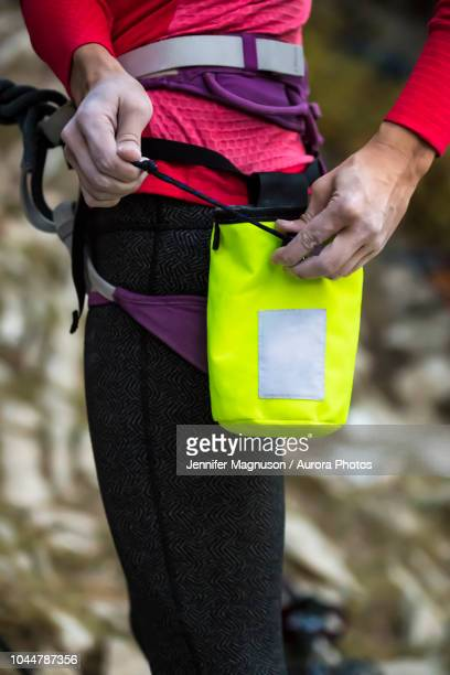 climber tying chalk bag, wyoming, usa - chalk bag stock pictures, royalty-free photos & images