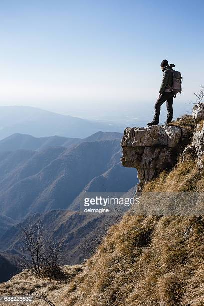 Climber watches a mountain valley