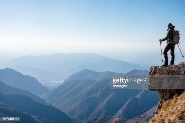 climber watches a mountain valley - explorer stock pictures, royalty-free photos & images