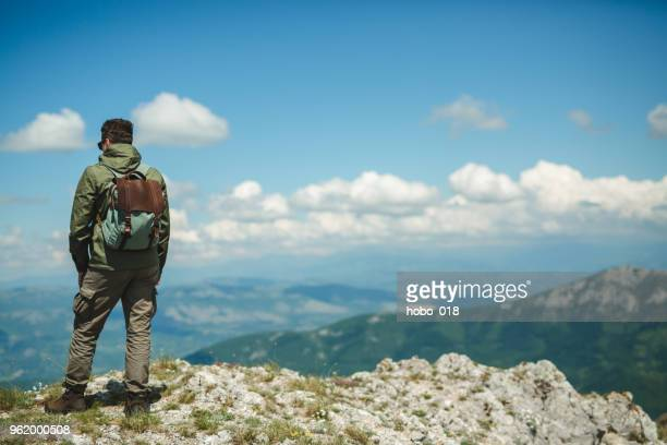 Climber watches a mountain valley