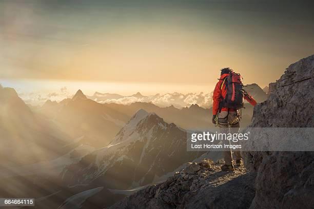 climber watching a mountain range at sunset, alps, canton wallis, switzerland - zermatt stock pictures, royalty-free photos & images
