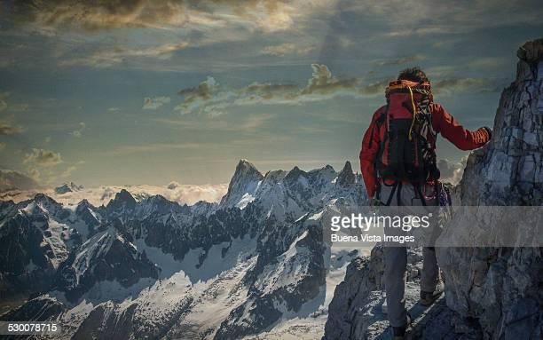 Climber watching a mountain range