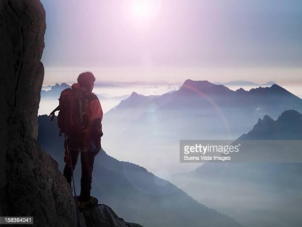 climber watching a mountain ridge - valle d'aosta foto e immagini stock