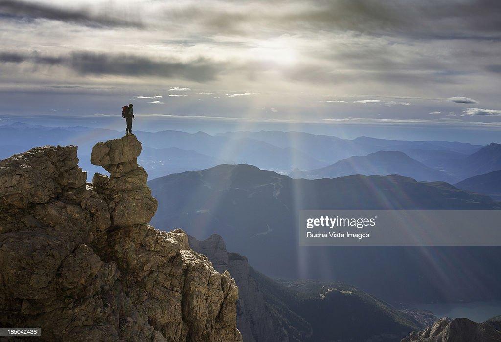 Climber watching mountain range : Stock Photo