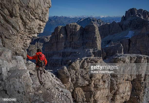 Climber watching mountain range