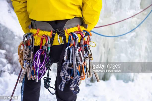 climber wears tools for ice climbing. valmalenco, valtellina, lombardy, italy, europe. - 登山用具 ストックフォトと画像