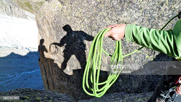 A climber with a rope in his hand