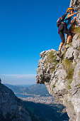 Climber woman on equipped rockface